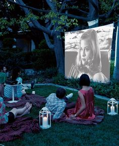 Throw your own film festival under the stars by projecting a movie in your backyard. Candlelit lanterns, fl...