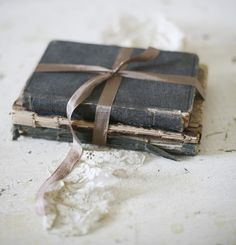 grey antique books tied with ribbon