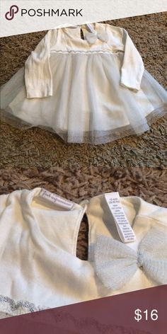 Baby Girl Tutu Dress Top Gently used, only worn once or twice. Beautiful long sleeve, full Tutu skirt. Beautiful silver bow embellishment. Purchased at Macy's Shirts & Tops Blouses