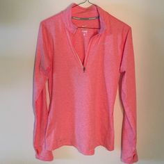 Nike half zip in coral Brand new, never worn Nike half zip. Coral color with gray reflective details. Dri-fit. Thumb holes in the sleeves. Nike Tops