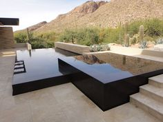 unique pool and spa combination. Both bodies of water include a vanishing edge where water slides down the face of the elevated pool and spa and is pumped back up to overflow again. Black granite tile is on the face Backyard Pool Designs, Swimming Pool Designs, Pool Landscaping, Backyard Pools, Pool Decks, Infinity Pools, Infinity Edge Pool, Infinity Pool Backyard, Luxury Swimming Pools