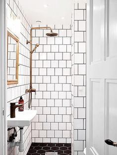 for a small guest bath: white square tiles, black grout, brass details Bad Inspiration, Bathroom Inspiration, Bathroom Renos, Small Bathroom, Gold Bathroom, Bathroom Ideas, White Bathrooms, Bathroom Fixtures, Basement Bathroom