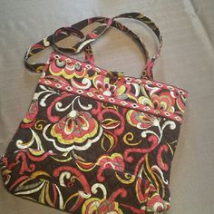 Vera Bradley Chocolate Brown Tote Pretty red, yellow, orange floral tote! Background color is chocolate brown. Used 2-3 times, very clean! Vera Bradley Bags Totes