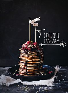 Coconut pancakes with raspberries and chocolate sauce