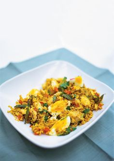 Kedgeree. Fresh parsley is good 100g of rice maybe 80g Fillet of smoked haddock 1 egg. Half or even quarter spices  Keep milk for omelettes or sauces