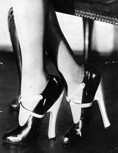 1920's shoes - High Heels - Black patent shoes, with white straps and heels - Getty Images