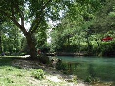 Roaring River - Cassville, Missouri.  My husband's favorite place to trout fish.  My favorite place to read a good book.