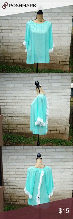 """Tiffany Blue Sheer Ruffled Boho NWT Blouse S Lillypad Brand Tiffany Blue Semi Sheer Boho Chic blouse . New with tags. Quarter sleeves with ruffle edges and ruffles along the edges in back drape pieces. Back pieces open in a Vshape while being worn .  Tagged size Small. Very boho gypsy style.  Measurements : Length 29"""" 17""""across front laying flat  #ravenkittystyle #tiffanyblue #semisheer #ruffles #boho #bohemian #bohochic #small #drape #springbreak #spring #summer #stylish #boutique Lillypad…"""