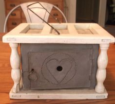 Antique wood foot warmer with heart punched tin, oyster paint