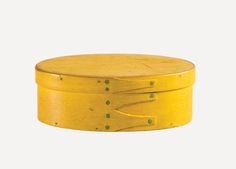 """Lot 121: Rare Small Oval Box SOLD: $14,000 ..Estimate: $4,000 – $7,000 Maple and pine, original chrome yellow painted finish, three fingers, signed in pencil under lid in script """"Flora Newton, Age 13 April …"""", found with eight small spools inside, possibly Enfield, NH, c. 1830-1840, 1 3/16″ h, 3 3/16″ l, 2″ d. This is the second smallest box in chrome yellow that we have ever sold. This box  is a rare gem of Shaker craftsmanship."""