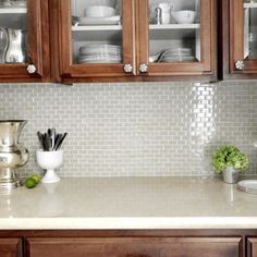 Gray glass tile backsplash
