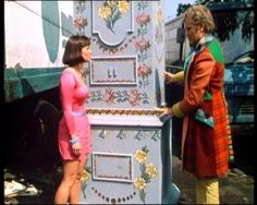 The Sixth Doctor and Peri with The TARDIS while it's Chameleon Circuit was working. From The Attack Of The Cybermen.