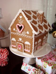 December 12 is National Gingerbread House Day! Here is a nice gingerbread house tutorial. Gingerbread House Designs, Gingerbread House Parties, Christmas Gingerbread House, Gingerbread Man, Gingerbread House Template, Gingerbread Village, Gingerbread Cookies, Christmas Goodies, Christmas Treats