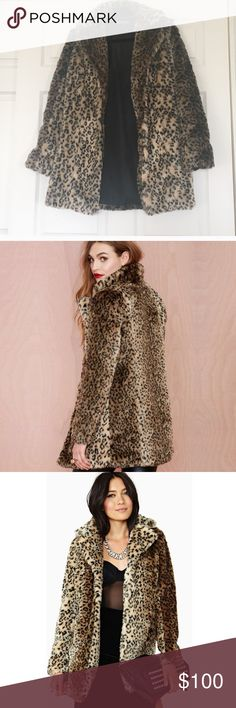 Nasty Gal faux fur leopard coat Like new with a tags on the shoulder. Love love love this coat but it's a little more fitted than I️ usually wear. I️ prefer boxy, this has more of a waist to it. Gorgeous, perfect length, perfect condition. Can be glam or rock n roll. Price firm. Nasty Gal Jackets & Coats