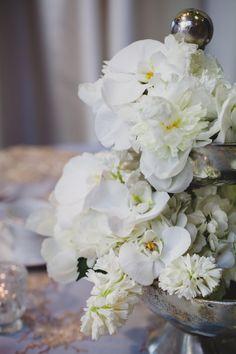 White floral wedding centerpiece. Orchids   Wedding Decor   Edmonton Photographer Kristin Zabos
