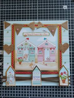 Hunkydory Crafts Sun Sea and Sandcastles Collection. Here comes the sun card with mini bunting and cork embellishments.