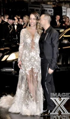 THE 2012 BRITISH FASHION AWARDS  British Singer Delilah Wearing An lntricately Sequinned Embellished Long-Sleeved Feathered Julien MacDonald Gown Accompanied By the Designer Himself