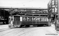 """CTA 5565 on September 10, 1949. This was known as a Brill-American-Kuhlman car. M. E. writes, """"Methinks this photo is at Root St. (4130 South) and Halsted. Under that assumption, the view faces north, the L is the Stock Yards L, and the streetcar is on the 44 Wallace-Racine line, heading from westbound on Root to southbound on Halsted."""""""