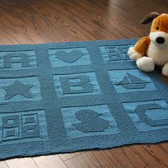Swathed in this blanket knit with the heavenly soft Knit Picks Comfy Worsted, your little one is sure to find sweet dreams. Garter stitch borders surround 9 classic baby blocks including A, B, C, a duck, a sailboat, a heart, a star and two 4-square blocks. Easy enough for a beginner to knit, this blanket is sure to become a treasured favorite.
