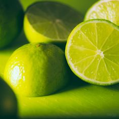 Lime sliced on a cutting board. Beautiful Sunset, Beautiful Images, Green Lemonade, Fruit Photography, Go Green, Fruits And Vegetables, Shades Of Green, My Favorite Color, Emerald Green