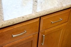 "Starmark Bridgeport Caramel Kitchen Cabinets with Chakra Beige Countertops with 1-1/2"" Bullnose Edge"