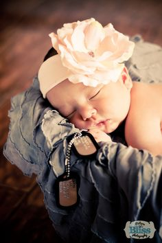 Newborn baby girl in vintage ceramic bowl with her daddy's dog tags. Gray ruffles, big pink flower, military picture.   Newborn Photography by KristinBliss.com in Columbus, OH