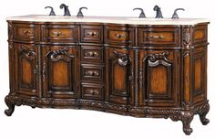 Delicately carved with an Ivory Cream marble top, this sink chest is large on beauty. Complete with two spacious cabinets, four drawers, elegantly carved legs and gorgeous hardware. www.mkhomedesign.com