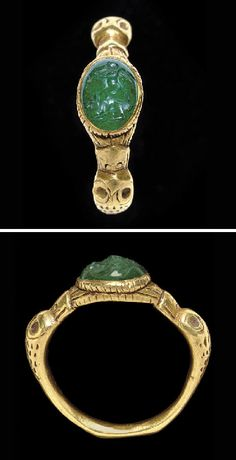 A ROMAN GOLD AND EMERALD FINGER RING   CIRCA 3RD CENTURY A.D.   The hoop solid cast, the shoulders in the form of duck heads with sunken eyes and stippling for the feathers, their bills merging with the stepped oval bezel, its sides enhanced by hatching, set with an earlier 1st century A.D. convex oval stone engraved with a winged nude Eros riding on the back of a mouse, the Eros playing an aulos, on a groundline Roman Jewelry, Jewelry Art, Gold Jewelry, Jewelry Rings, Jewelery, Jewelry Design, Renaissance Jewelry, Medieval Jewelry, Ancient Jewelry