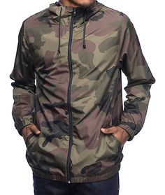 Amp up your wardrobe with a design that is stylish and functional. This edgy windbreaker from Zine has a comfortable design, lined with black knit for comfort and finished with elastic sleeve cuffs and bottom hem. The camo print adds a street tone that go