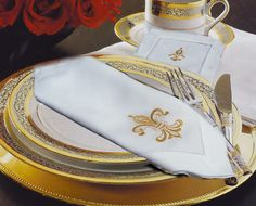 Elegant French styling and antique Fleur De Lys embroidery on crisp white linen.  Hemstitch border.  Imported.  100% linen.  Available in matching cocktail napkins and guest towels.  Fleur De Lys pattern comes in White, Gold or Antique Brass Embroidery.