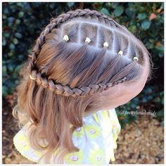 """A fun elastics style with a Dutch braid at the back and a lace Dutch braid collecting the hair from the elastics with a pony slightly to this side…"""