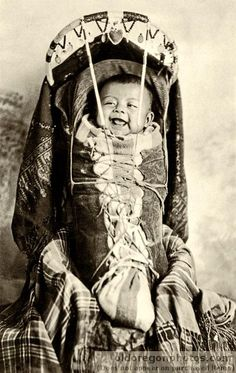 Papoose, The Dalles, Oregon. c 1925. This baby is in a cradle board, the Native American baby-carrier of choice!