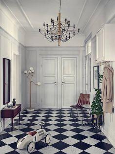 Przedpokój, stare drzwi, podłoga w kratę, białe drzwi