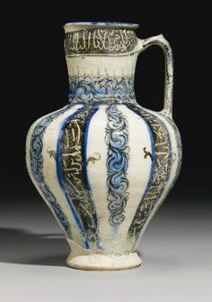 A Kashan ewer painted with stylised vegetal decoration and inscriptions, Persia, early 13th Century - Sotheby's
