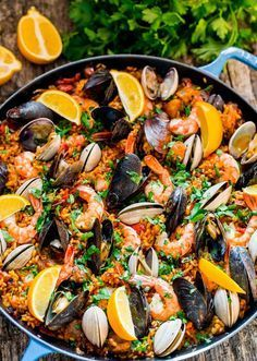 Chicken and Seafood Paella - a classic Spanish rice dish made with Arborio rice, packed with chicken, sausage, mussels, clams and shrimp and loaded with flavor. Fish Recipes, Seafood Recipes, Mexican Food Recipes, Chicken Recipes, Cooking Recipes, Healthy Recipes, Recipe Chicken, Simple Recipes, Meat Recipes