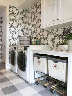Laundry room - mixing patterns with gray and white modern floral wallpaper and large buffalo check made with floor tiles.  Love this look!!!!