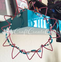 Colorful and fun wire craft for kids. Hang it on a wall in their bedroom!