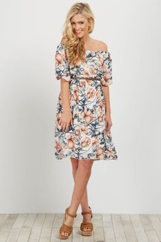 7615a07865875 Floral off shoulder dress. Belted. Short sleeves. Double lined to prevent  sheerness.