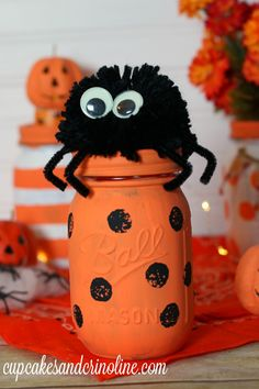 Decorate some super cute mason jars for Halloween with paint, stripes and polka…