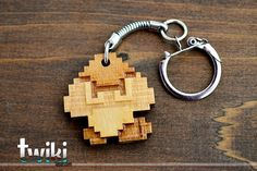 Laser cut and engraved Mario Bros 8 bit Goomba wood keyring. By TwikiConcept on Etsy