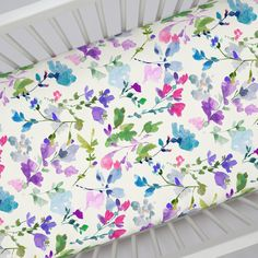 """Crib Fitted Sheet in and Bright Wildflower by Carousel Designs.  Our fitted crib sheets feature deep pockets and have elastic all the way around the edges to hug mattresses securely. Fits standard crib mattresses, measuring approximately 28"""" x 52""""."""