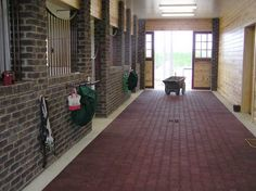 Brick Stalls, rubber walkway   Um, that kinda looks like a horse jail, because of the bars on the horses windows