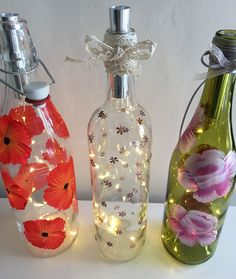 Lighted bottles, set of three, recycling, upcycling, wine bottles, lights, wedding gift, Easter gift, hand painted, poppies, daisies by DragonflyArtDesign1 on Etsy