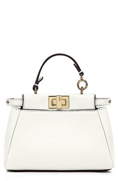 Free shipping and returns on Fendi 'Micro Peekaboo' Nappa Leather Bag (Extra Small) at Nordstrom.com. A tiny bag with major impact, Fendi's Micro Peekaboo is the perfect complement to your spring and summer style. Fresh from the runway, this compact bag is crafted from supple Nappa leather in rich hues, highlighted by a logo-etched turnlock closure and gleaming hardware. S15