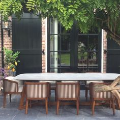 Skilled craftsmen make our outdoor arm chairs in England using Coco Wolf's innovative designs and marine grade materials. The outstanding quality of our outdoor chairs makes them ideal for bars, hotels, private members clubs, residential and marine projects. Explore our range of outdoor commercial chairs designed to be as versatile as possible including tall-back arm chairs, corner chairs and more.   Molverno Armchair Perseus Dining Table Outdoor Armchair, Outdoor Dining Chairs, Outdoor Furniture Sets, Dining Table, Outdoor Decor, Luxury Restaurant, Restaurant Tables, Restaurant Design, Contemporary Chairs
