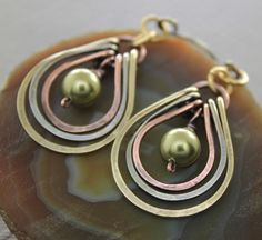 Multicolored metal earrings with copper, German silver and brass hoops with green Swarovski pearls