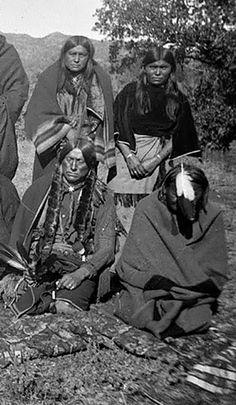 Quanah Parker, Comanche leader sitting left – 1892