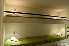 built-in bunks in a ski cabin from afgh architects