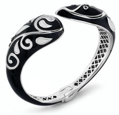 Black spinel and white topaz decorate this black and white enamel bypass bangle.