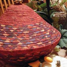 This beautiful fall colored basket with a matching lid will make a stunning accessory while decorating with Autumn home decor.